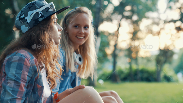 Young smiling girls outdoors - Stock Photo - Images
