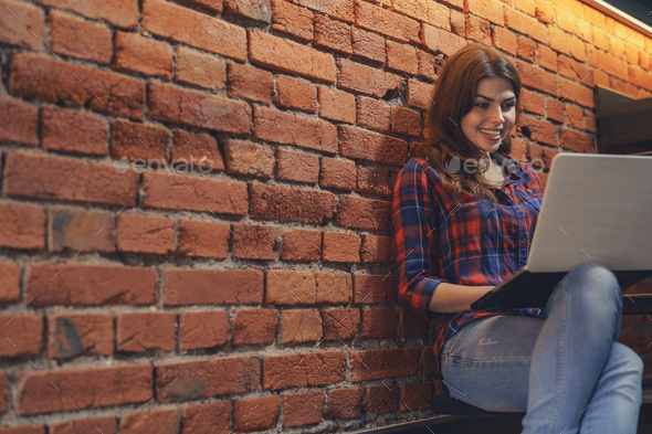 Young attractive woman with laptop - Stock Photo - Images