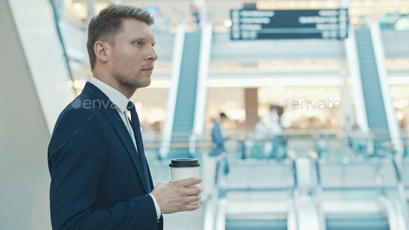 Young businessman with coffee - Stock Photo - Images