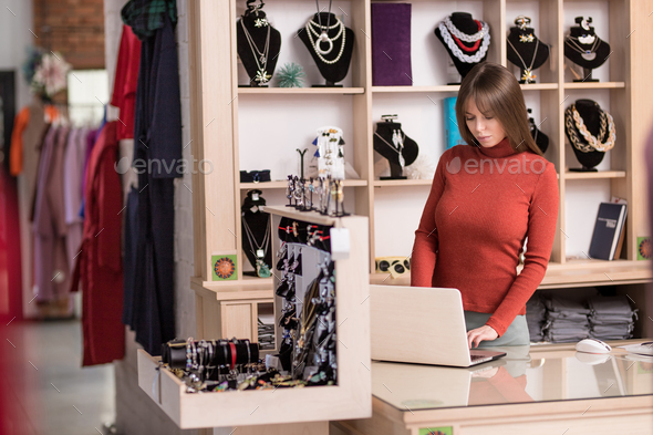Young cashier at the counter - Stock Photo - Images
