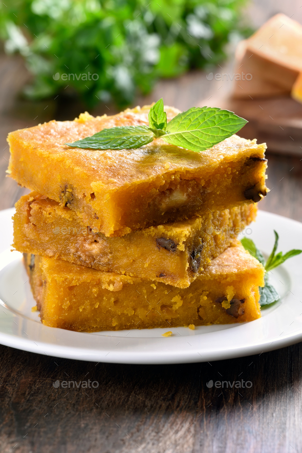Sliced pumpkin pie with nuts - Stock Photo - Images