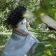 Beautiful Brunette in Blue Dress Walking in Garden in - VideoHive Item for Sale