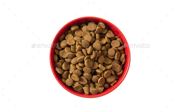 Dogs or cats dry food in a red bowl isolated on white background, top view - Stock Photo - Images