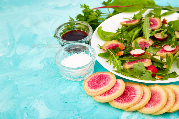 Salad in white plate around Ingredient - Stock Photo - Images