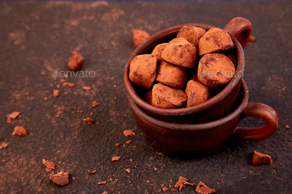 Chocolate Candy truffles in brown plate - Stock Photo - Images