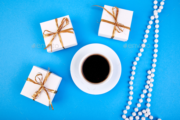 White gift box with gold ribbon - Stock Photo - Images