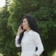 Beautiful Brunette Talks with Friend By Phone in Summer Park - VideoHive Item for Sale