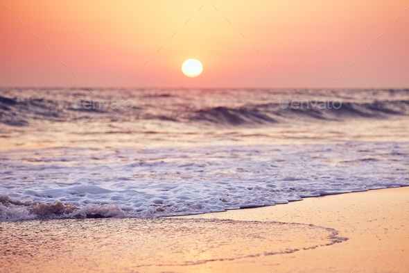 Idyllic sunset on the beach - Stock Photo - Images