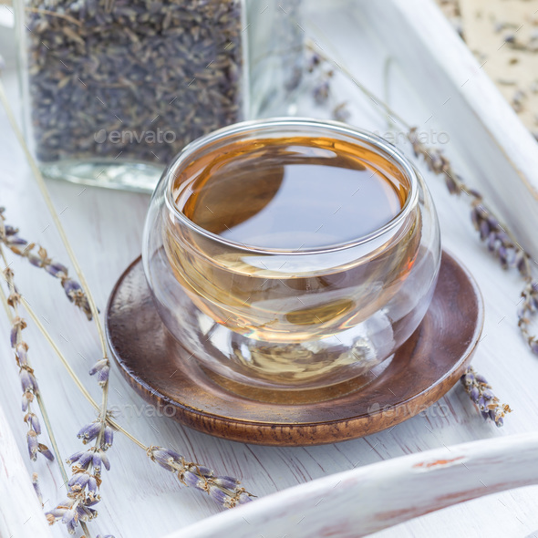 Healthy herbal lavender tea in oriental glass cup, square - Stock Photo - Images
