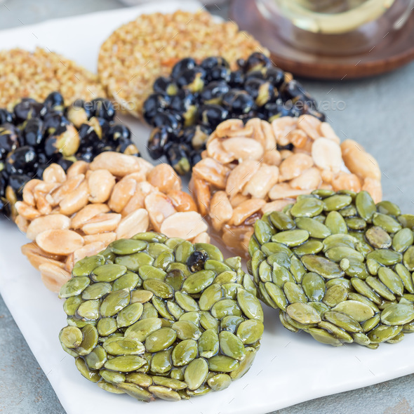 Korean traditional sweet snacks with peanuts, pumpkin seeds, bla - Stock Photo - Images