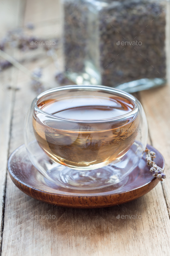 Healthy herbal lavender tea in oriental glass cup, vertical - Stock Photo - Images