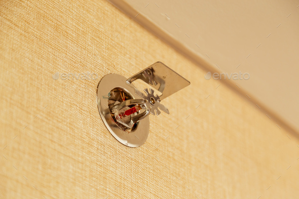 Fire sprinkler on a wall, fire emergency - Stock Photo - Images