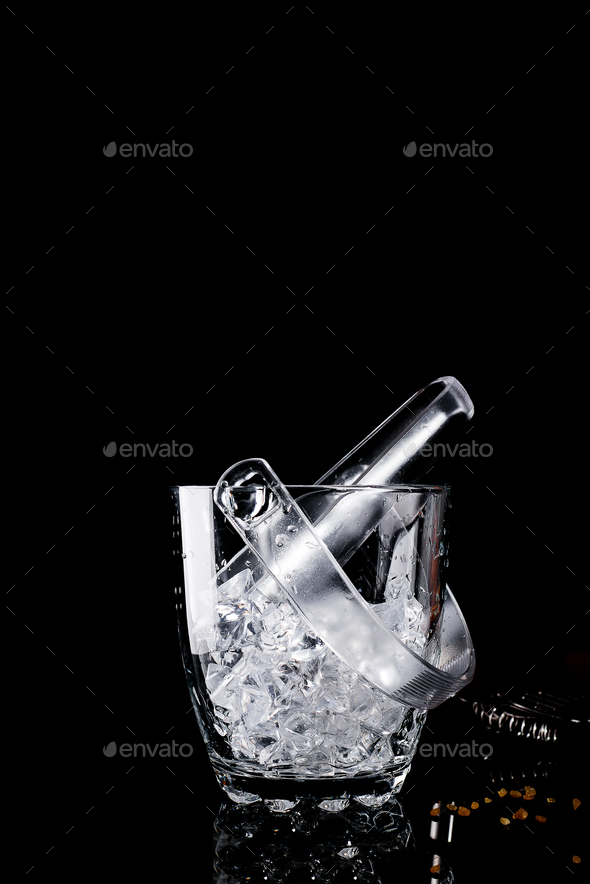 Glass ice bucket isolated on black - Stock Photo - Images
