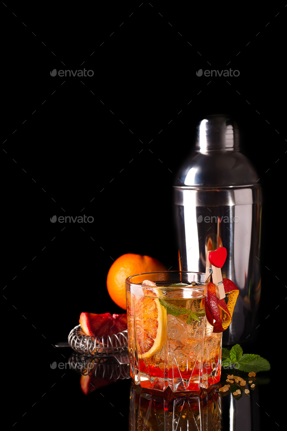 Blood Orange Margarita coctail with ice and mint isolated on black - Stock Photo - Images