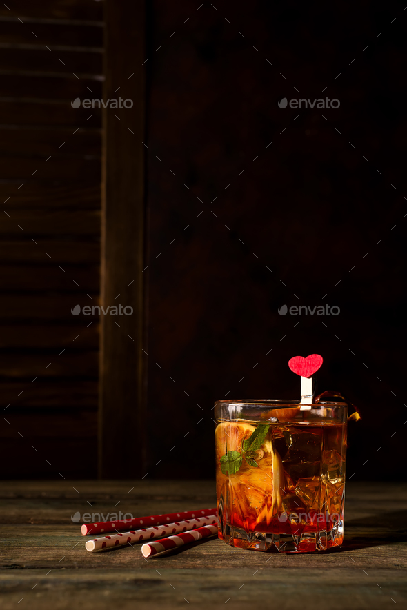 Blood Orange Margarita coctail with ice and mint on wooden background - Stock Photo - Images
