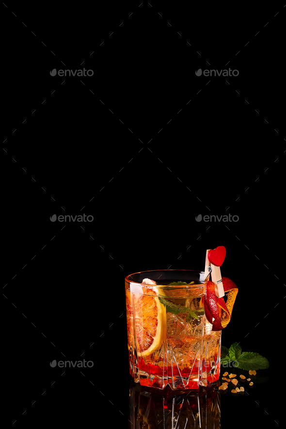 Blood Orange Margarita coctail with ice and mint on black - Stock Photo - Images