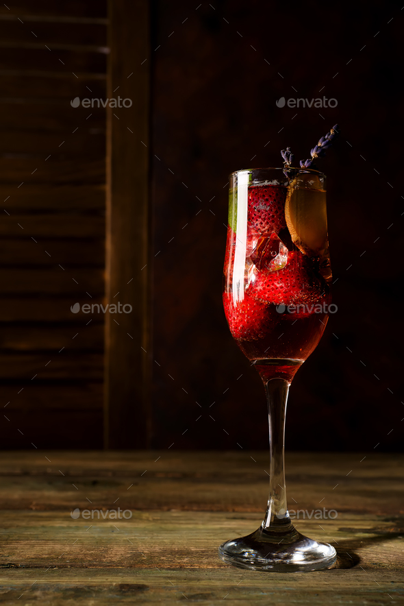 strawberry jive cocktail with ice and lavender on wooden background - Stock Photo - Images