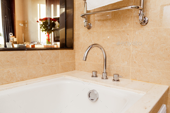 Luxury bath tub and faucet with water. - Stock Photo - Images