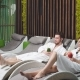 Pensive Couple in the White Bathrobes Sitting in the Loungers in Spa Center - VideoHive Item for Sale