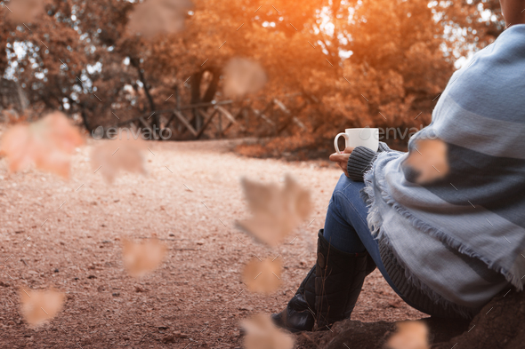 Drinking coffee in the autumn forest  - Stock Photo - Images
