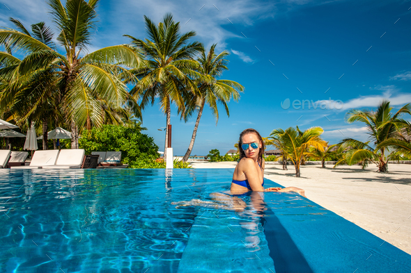 Woman at beach pool in Maldives - Stock Photo - Images