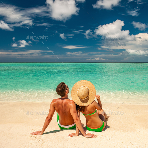 Couple on a beach at Maldives - Stock Photo - Images