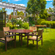dining table set in lush garden - PhotoDune Item for Sale