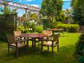 dining table set in lush garden - PhotoDune Item for Sale