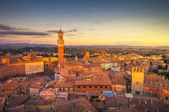 Siena sunset panoramic skyline. Mangia tower landmark. Tuscany, - Stock Photo - Images