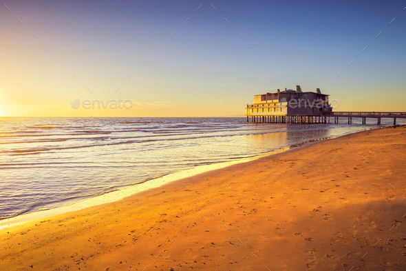 Pier and building on sea and beach. Follonica, Tuscany Italy - Stock Photo - Images