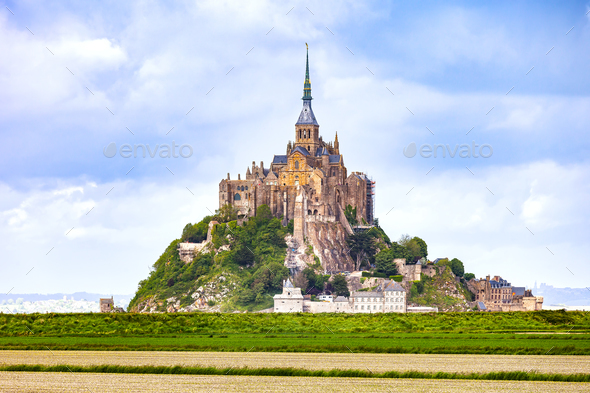 Mont Saint Michel monastery landmark and green field. Normandy, - Stock Photo - Images