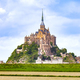 Mont Saint Michel monastery landmark and green field. Normandy, - PhotoDune Item for Sale