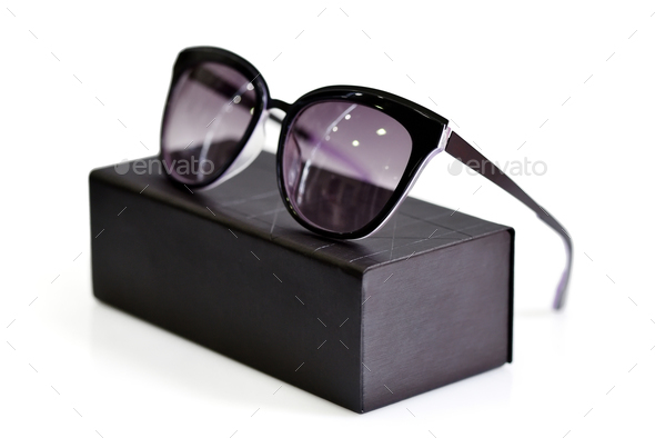 Fashionable sunglasses with box on white background - Stock Photo - Images