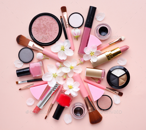 Decorative cosmetics with apple blossom on a pastel pink backgro - Stock Photo - Images