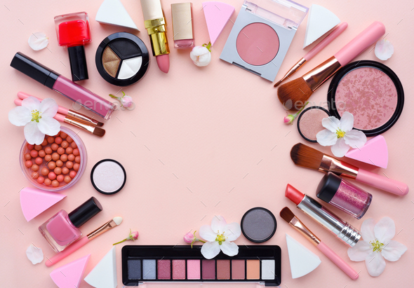 Makeup brush and decorative cosmetics with apple blossom arrange - Stock Photo - Images