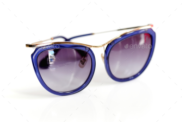 Stylish women's sunglasses on white background - Stock Photo - Images