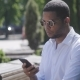 African American Man Sms Texting Using App on Smart Phone in City. - VideoHive Item for Sale
