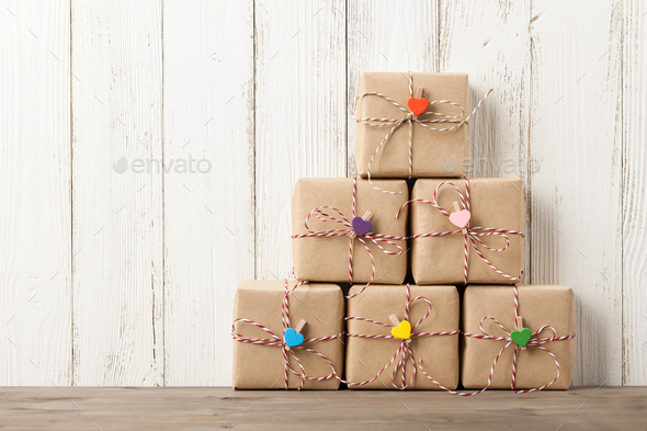 Wrapped gift boxes on wooden table - Stock Photo - Images