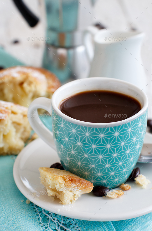 Cup of coffee with pasticciotto pastry on a rustic background close up - Stock Photo - Images