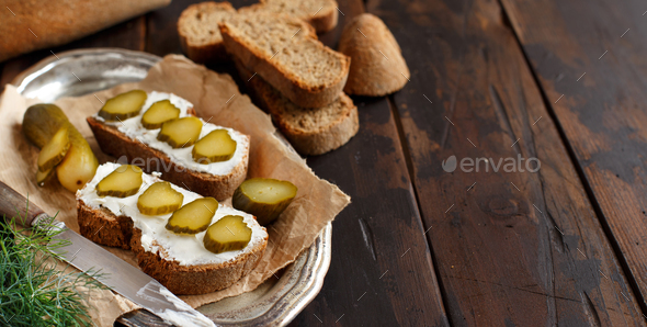 Sandwiches with cream cheese and salted cucumber - Stock Photo - Images