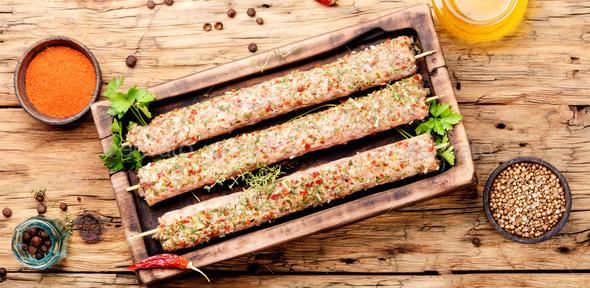Raw kebabs in skewers - Stock Photo - Images