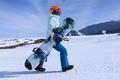 Snowboarder walking on alpine mountain slope - PhotoDune Item for Sale