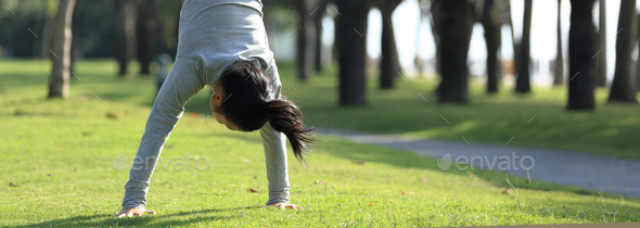Handstand on meadow in park  - Stock Photo - Images