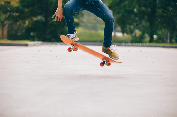 Skateboarder doing a trick ollie - Stock Photo - Images