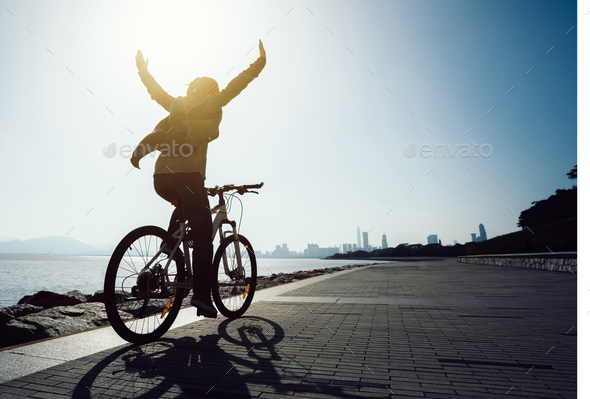 I can riding with hands outstreched - Stock Photo - Images
