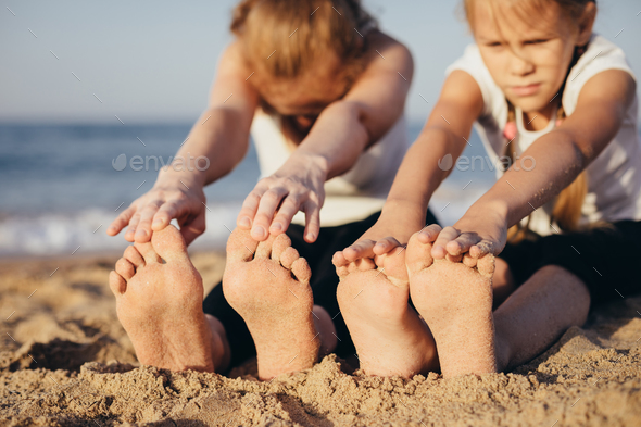 Happy family standing on the beach at the day time. - Stock Photo - Images
