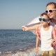 Mother and son standing on the beach at the day time. - PhotoDune Item for Sale