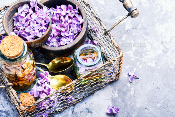 Bottle of lilac essential oil - Stock Photo - Images
