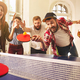 Group of happy young friends playing ping pong table tennis - PhotoDune Item for Sale