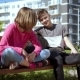Boy and Girl Sitting on the Bench - VideoHive Item for Sale
